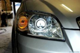 Installation of various lenses in the headlights of a car